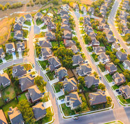 Aerial view of suburban housing near Austin Texas with bike path and green belt.
